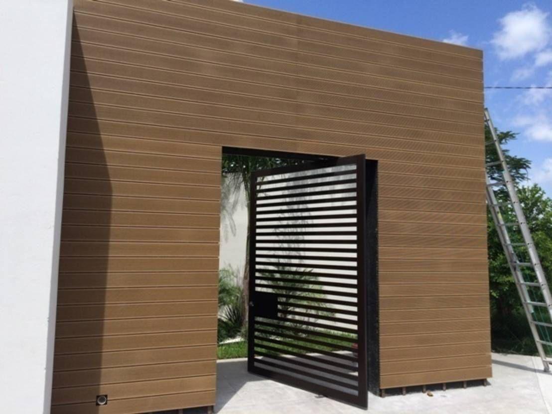 10 portones espectaculares para la entrada de tu garage for Puertas de madera para garage