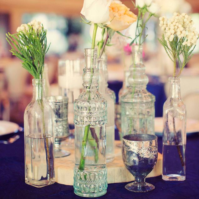 Small Clusters Of Glass Bottles Decorate Reception