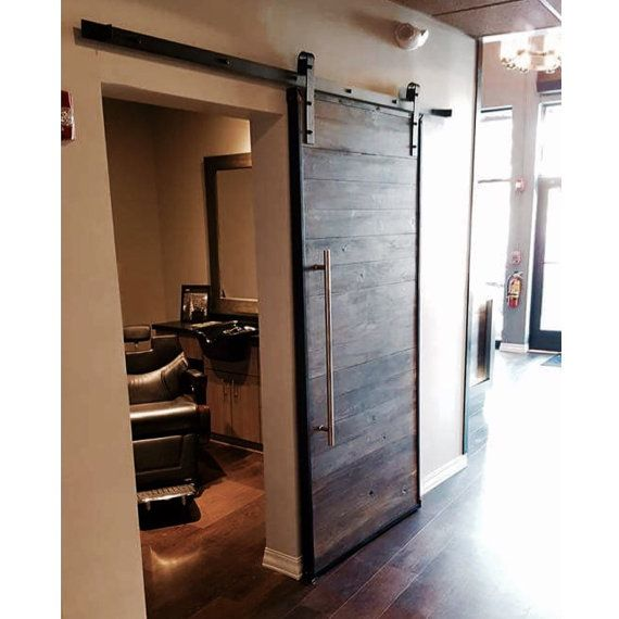 Industrial Weathered Horizontal Plank Sliding Barn W Metal Trim By Rustic Luxe This One In Part Plank Door Interior Barn Doors Interior Sliding Barn Doors