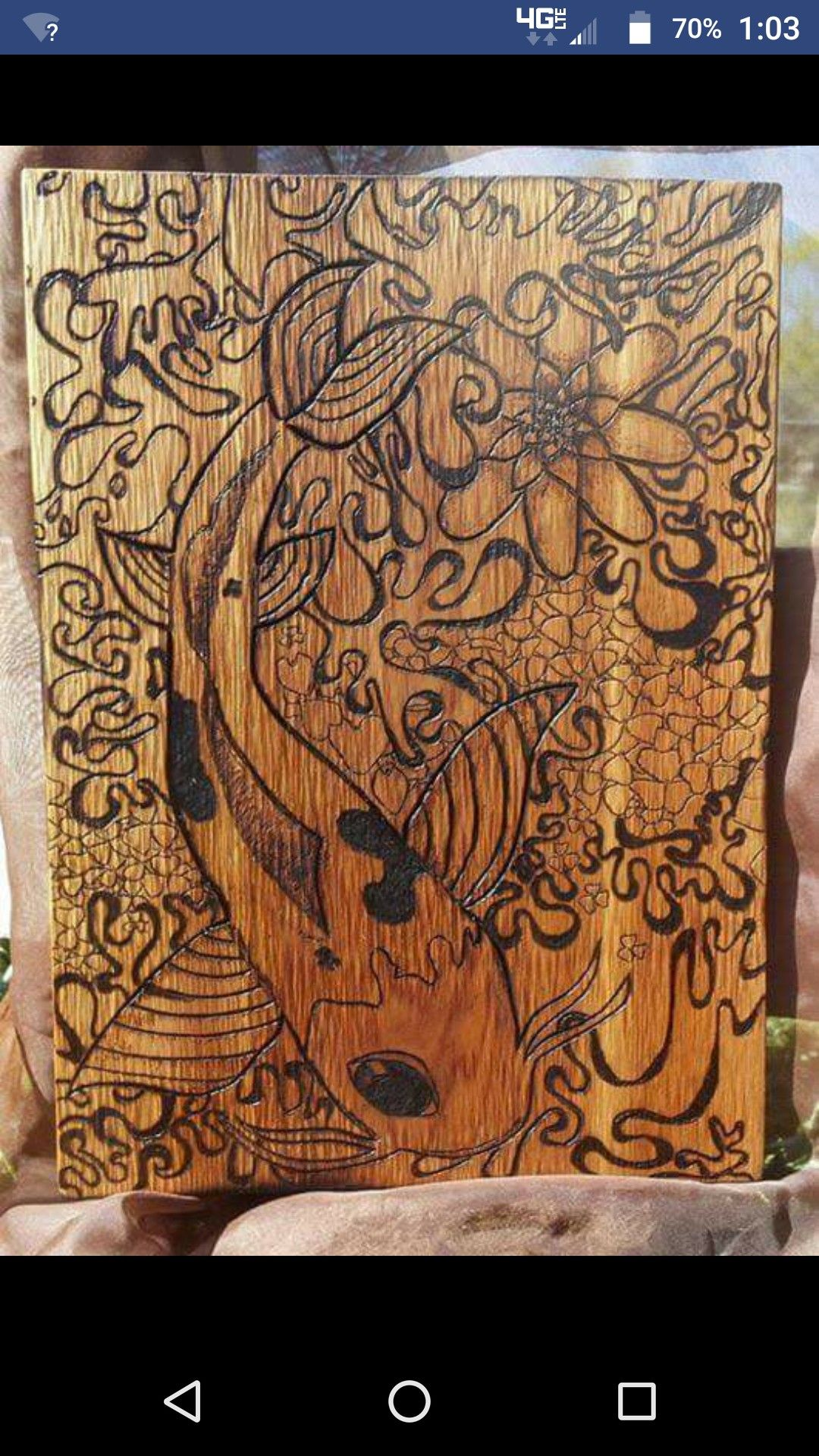 Koi design burnt into wood. Beautiful decoration.