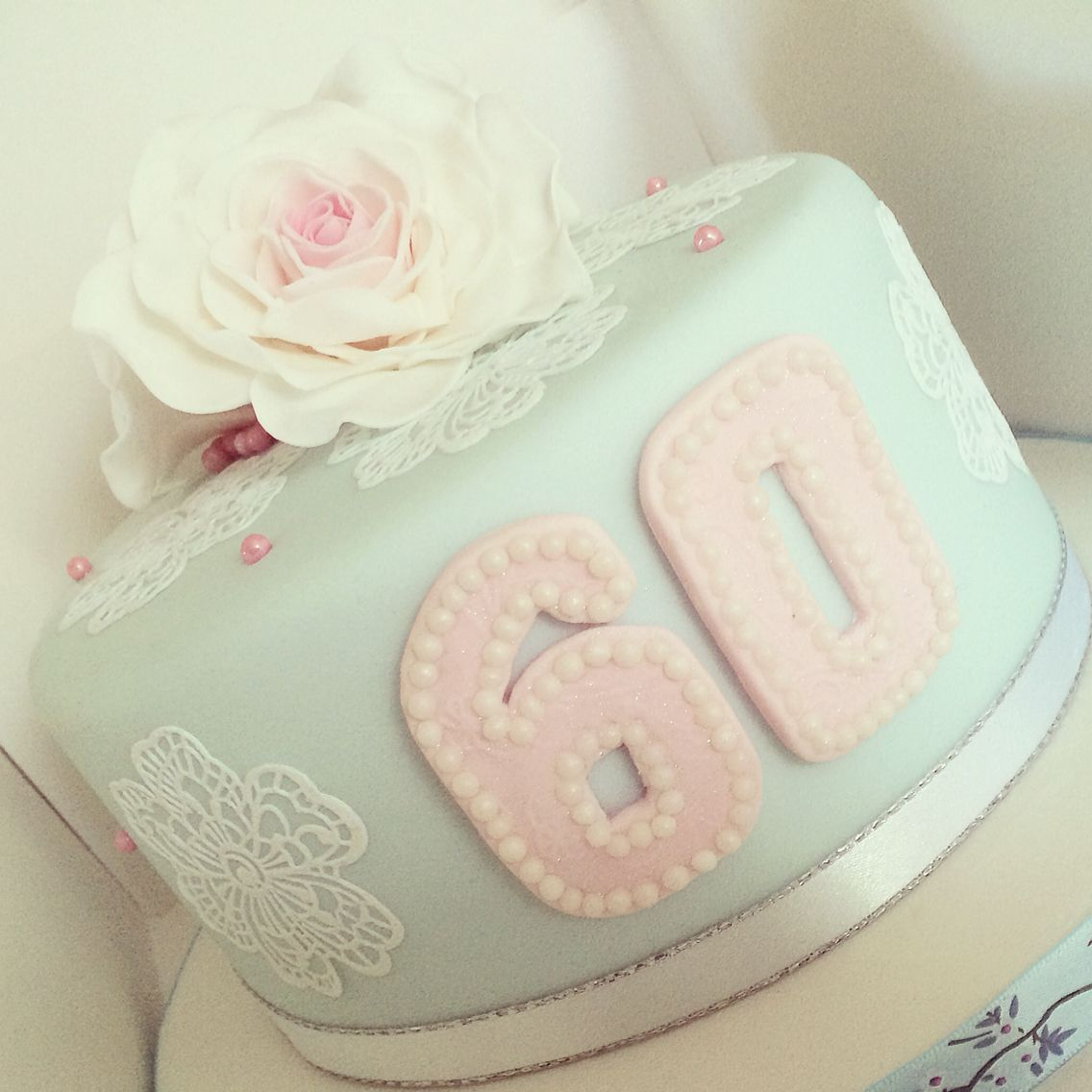 60th Birthday Cake with cake lace and hand made sugar flowers.