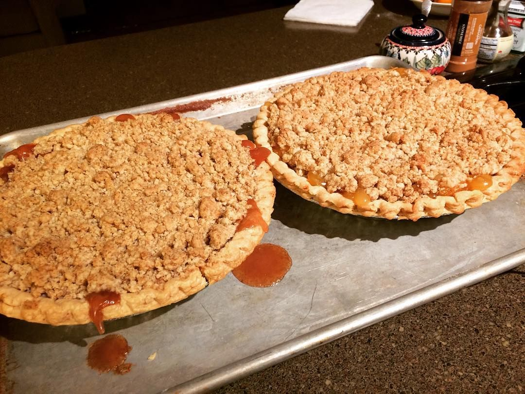 Apple and peach crumble pies for small group tomorrow. I used my homemade canned pie filling (store bought crusts ) and my go-to crumble topping recipe. Even though it's just fall there's nothing like opening up a jar of the seasons past. #homemade #canning #pie