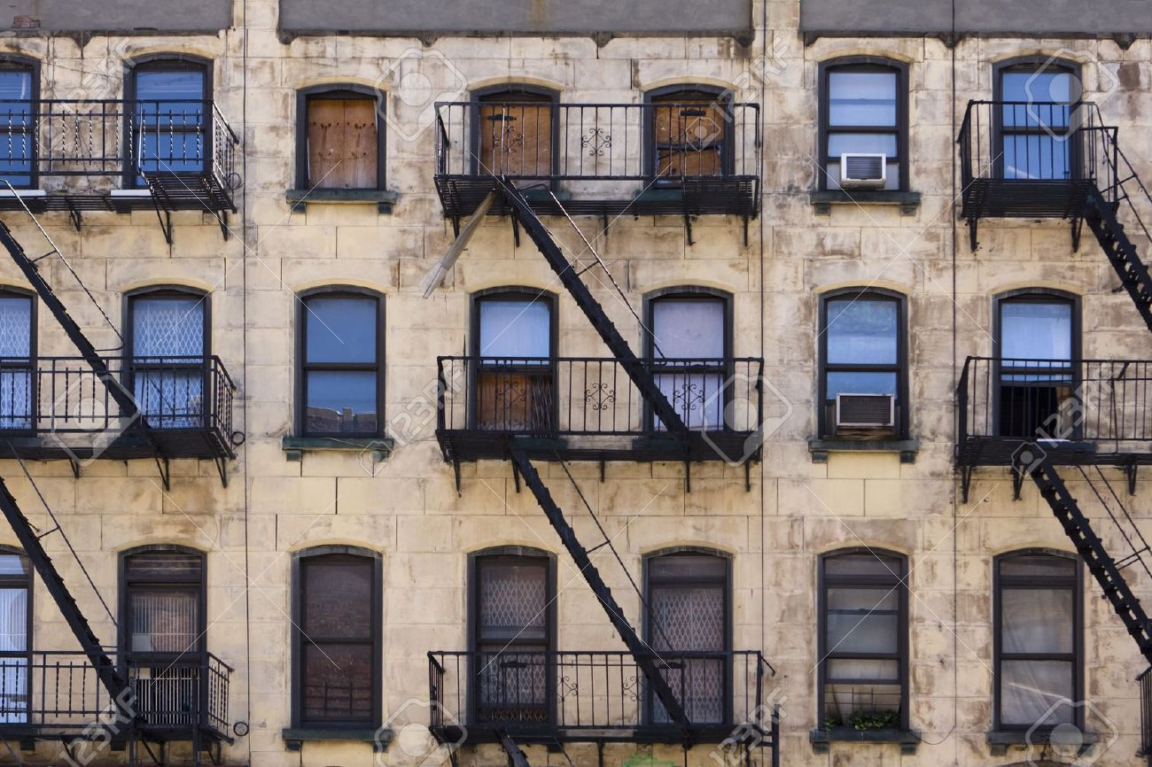 12387807 Three Floors Of Windows With Fire Escapes