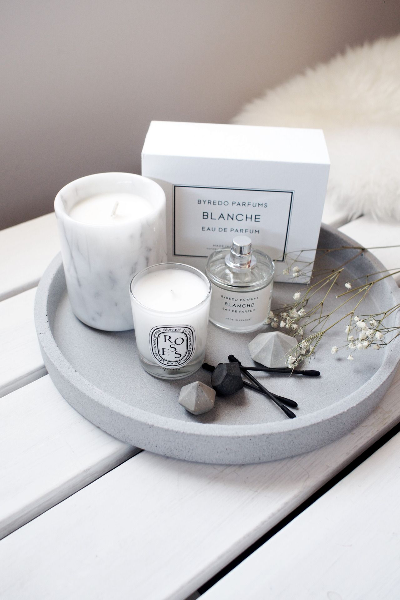 use a beautiful tray on the bathroom vanity to display and store