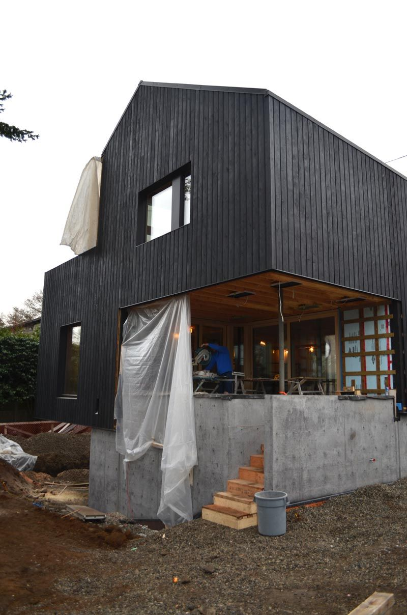 Flame stained vertical siding corner view new house - How to stain exterior wood siding ...
