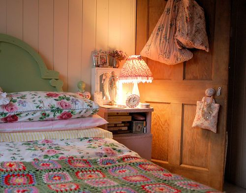 Mary on the bedside.  Vintage and Cath Kidston-ish and charming.
