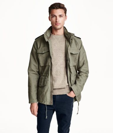 2ac4bb197ea Khaki green utility jacket in a washed twill with cargo pockets   concealed  hood.