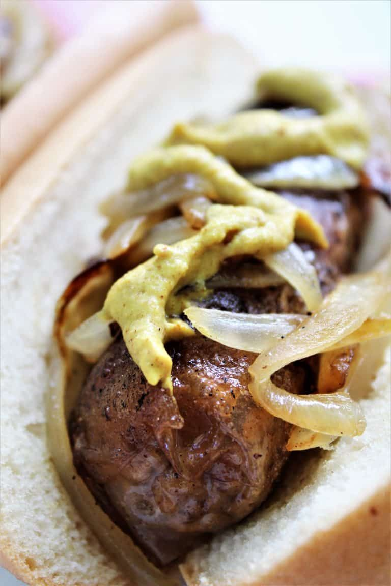 Vegan Beer Brat Sausage With Fried Onions And Mustard