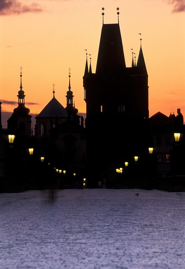 Silhouetted Towers of Prague, Charles Bridge over River Vltava , Prague, Czech Republic
