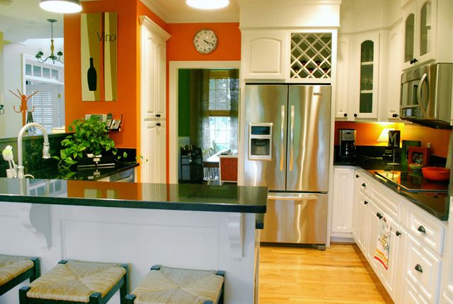 Orange kitchen accent wall.  Why can't I be this brave with color?