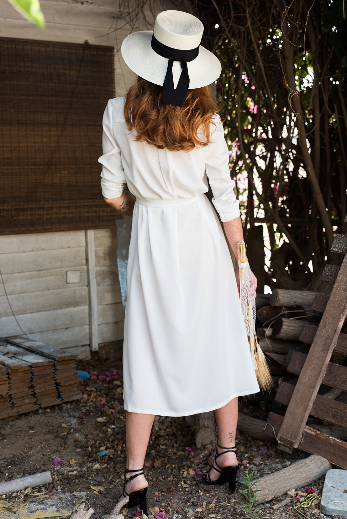 A white light crepe wedding midi dress elegant and seductive in