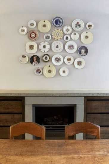 antique decorative plates on wall and vintage chairs for boho chic ...