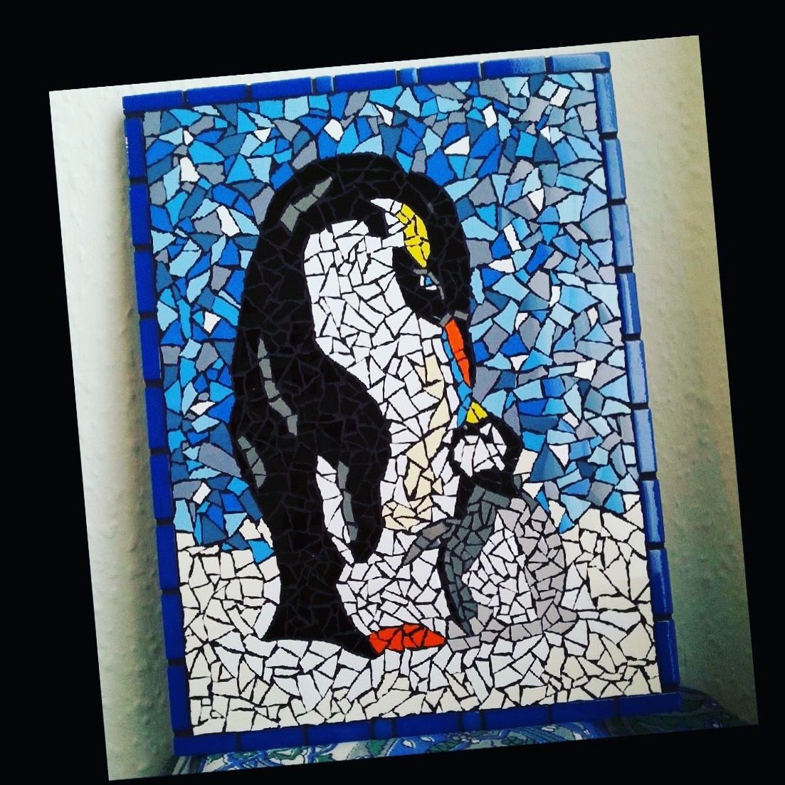 My mother and baby penguin. A mosaic created using ceramic tiles