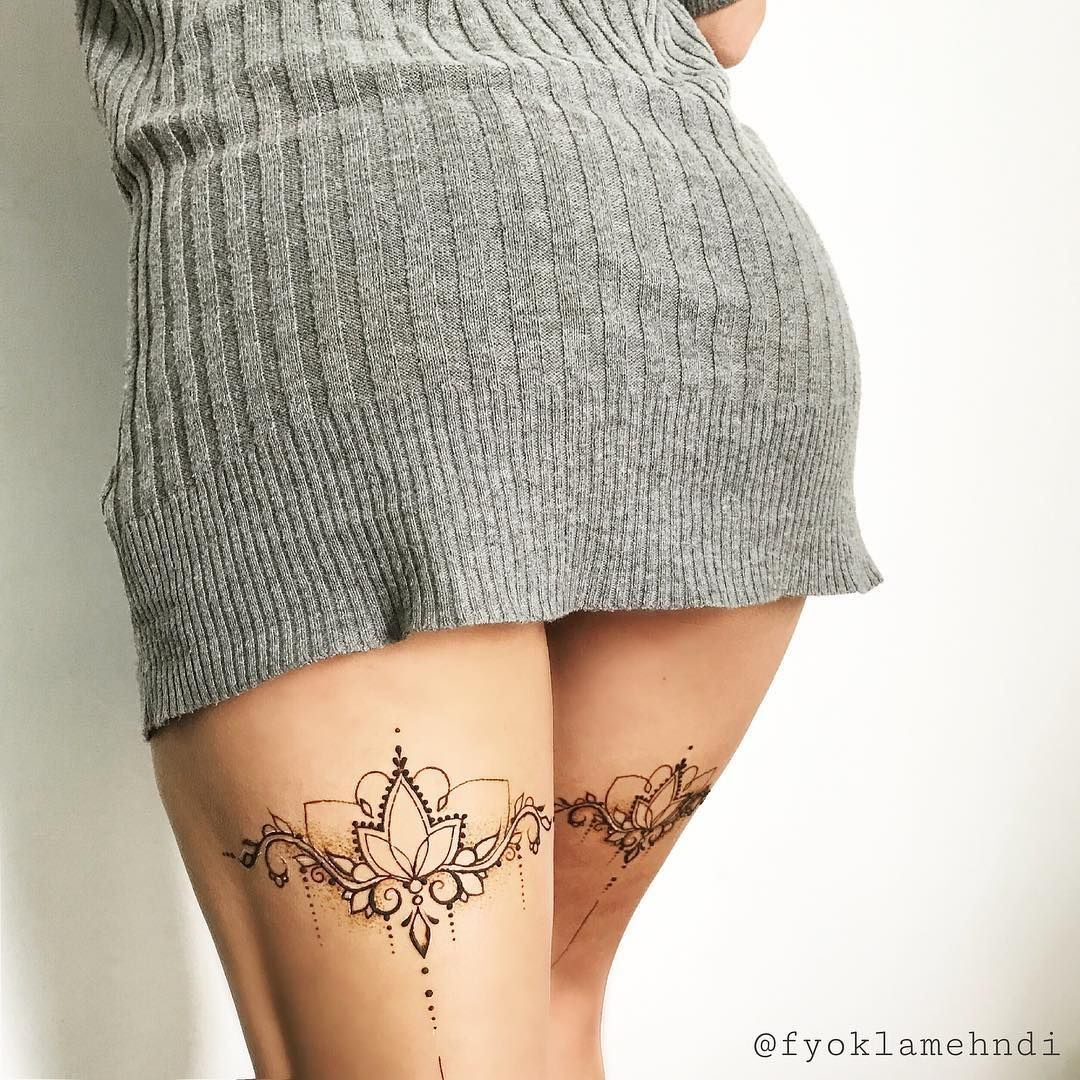 behind the legs tattoo. tatouages cuisses broderie.   tattoo