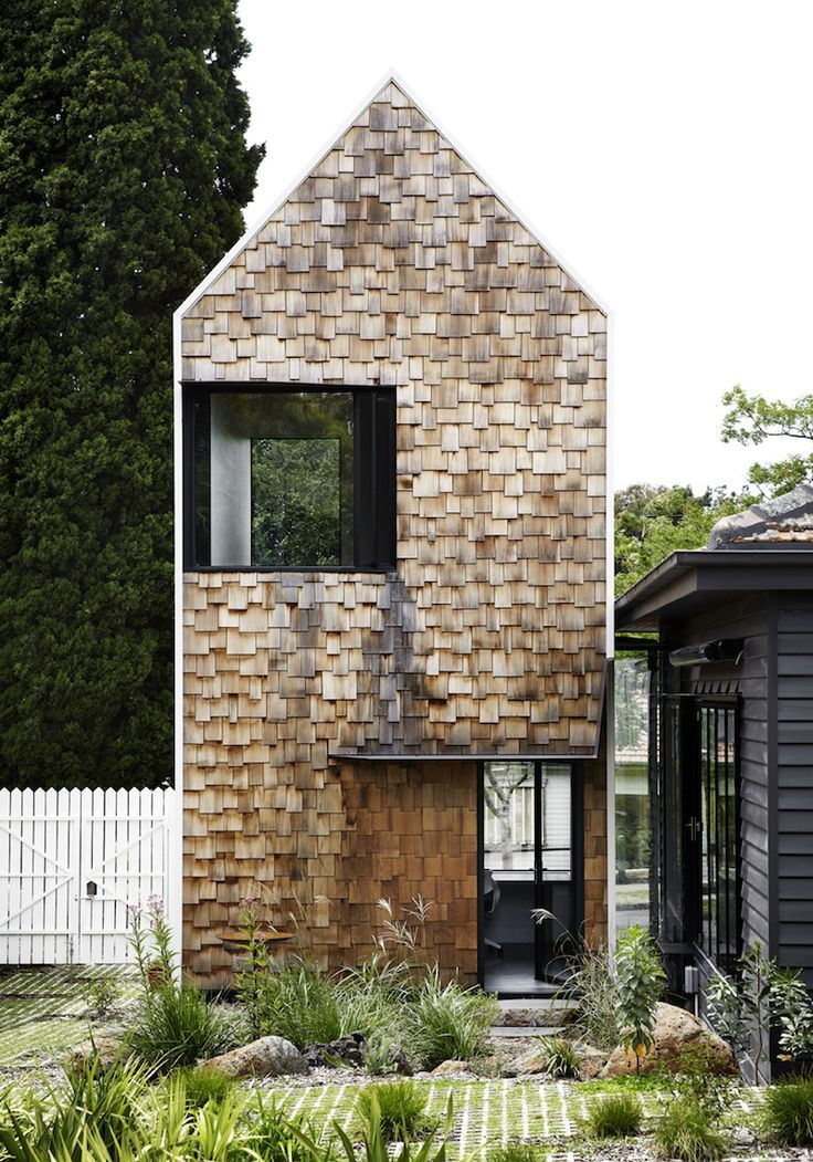 Andrew maynard s tower house is made up of seven small for Houses for small blocks