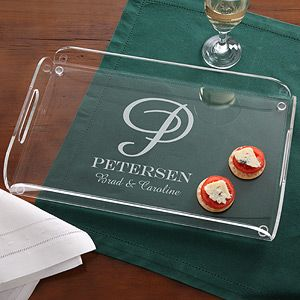 LOVE this! It's a monogramed serving tray! Would look great on the coffee table to hold magazines, remote controls, etc. Great wedding gift idea, too!