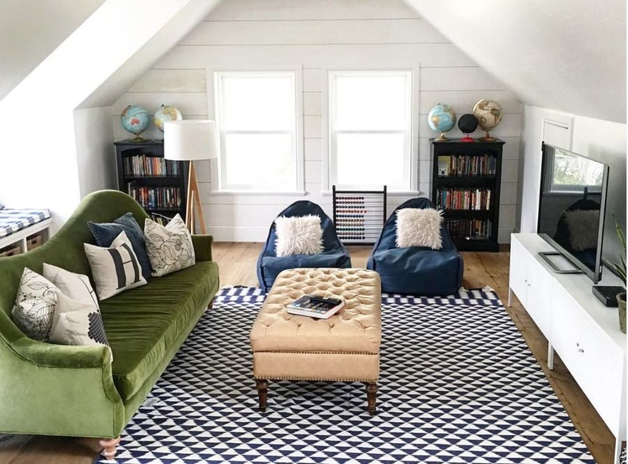 I like the simple plank wall in this family room. I saw it in person during the Utah Parade of Homes and loved the whole house but especially this cute attic space.   Home Tour- Eclectic Family Room and Gorgeous White Kitchen