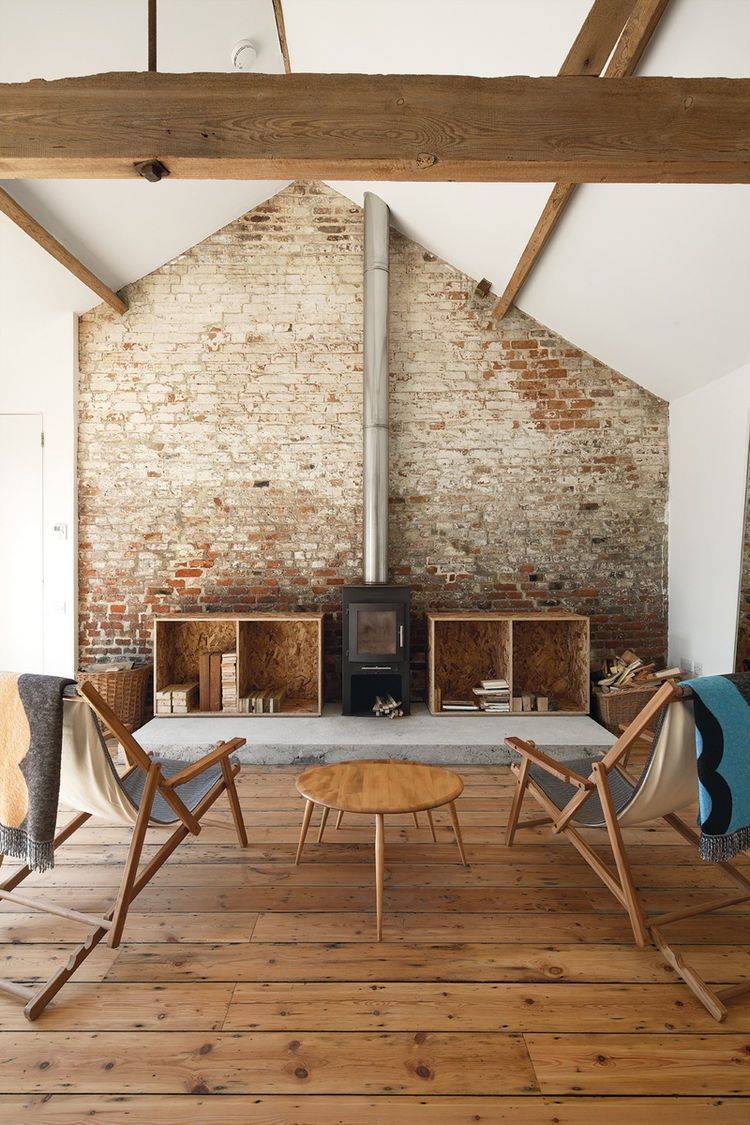 Renovated barn in England with oak floors and exposed brick wall and timber  beams