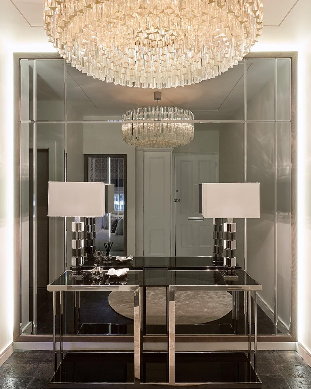 The Stunning Entrance Hall With Statement Chandelier And Mirrored
