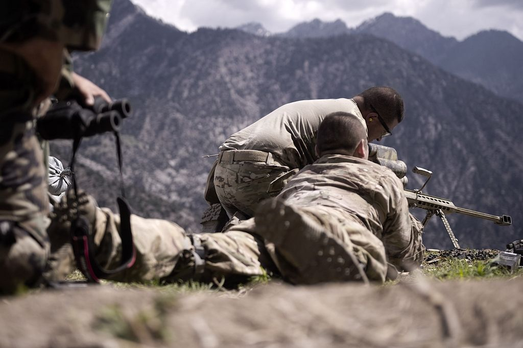 A United States Army sniper team set up a rifle during a mission in Nuristan province, Afghanistan, April 15. 2011.  (U.S. Navy photo by Mass Communication Specialist 2nd Class Clay Weis / Not Released)