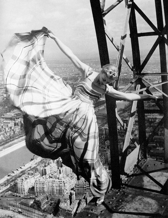 Fashion model, Lisa fonssagrives photographed on the Eiffel Tower by Erwin Blumenfeld, 1939