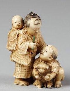 Netsuke of Children with Puppy. 19th century. Japan. Ivory. The Met