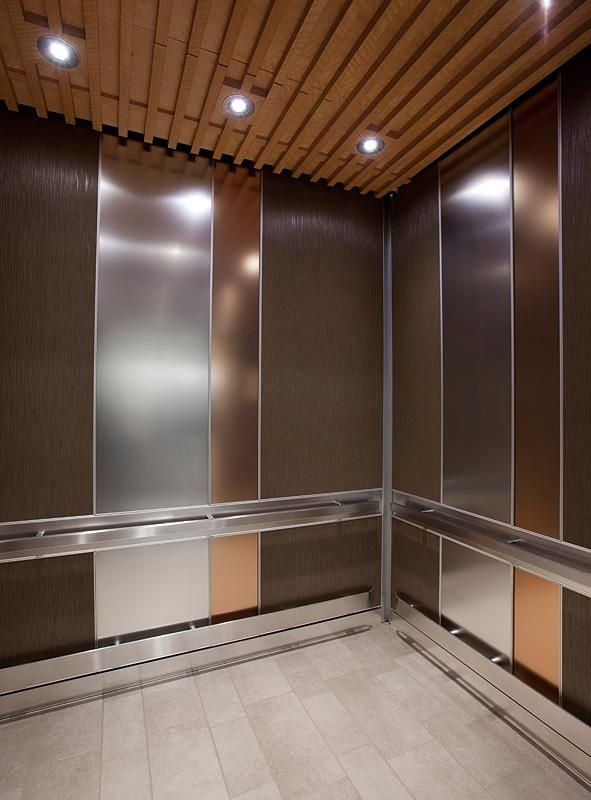 LEVELe101 Elevator Interior with main panels in Bonded Bronze with