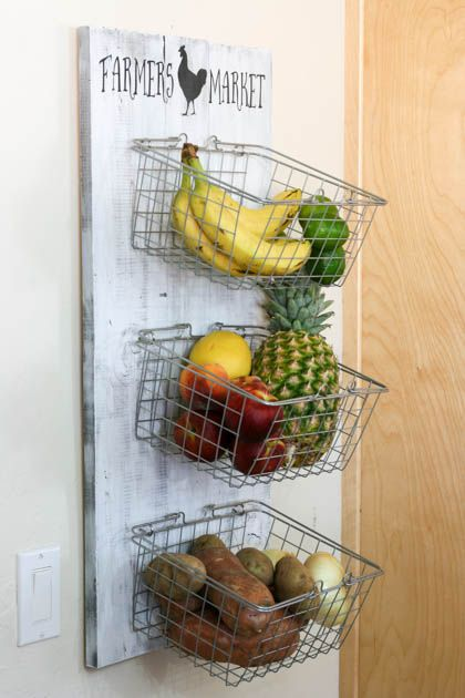 "Hmm...basket display for produce? It would free up counter space and the wire baskets minus the distressed wood and ""farmer's market"" verbiage would add a more modern feel."