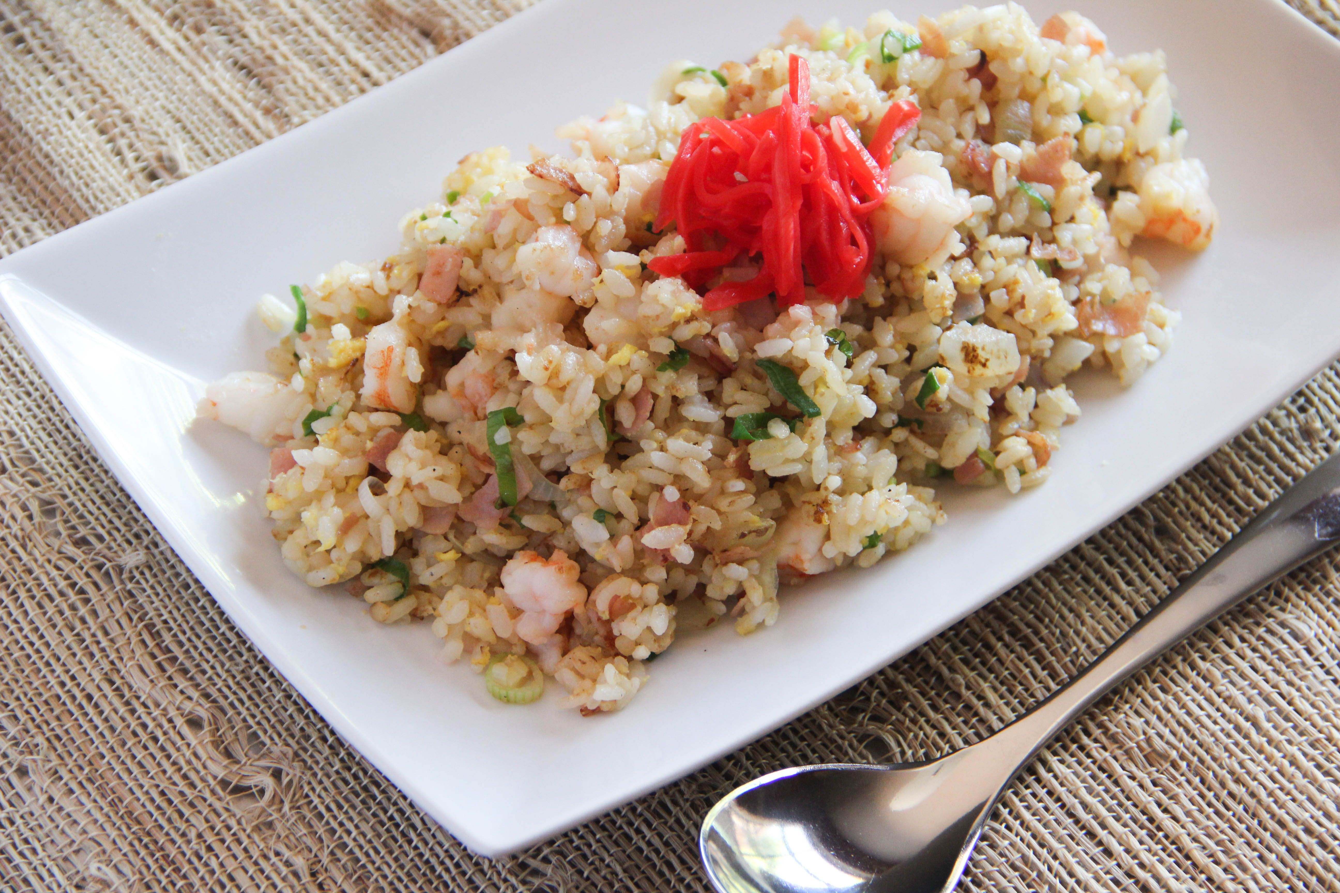 <p>Yakimeshi is Japanese fried rice with egg, meat, and vegetables.  Yakimeshi is something your mom makes from left over rice and ingredients she already has in the house.  Other than rice and egg, there are no particular ingredients you need to use.  Yakimeshi is quick and easy and also a