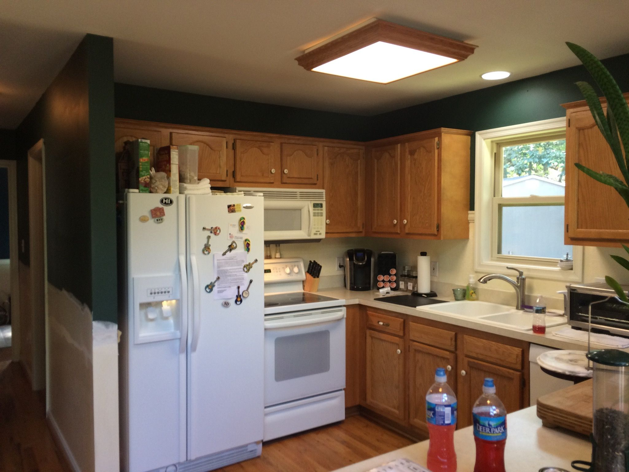 Before White Appliances Honey Oak And Hunter Green Walls Green Kitchen Walls Kitchen Remodel Green Kitchen