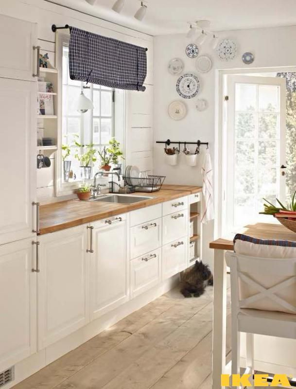 Love this Ikea Kitchen! White cabinets with butcher block countertops
