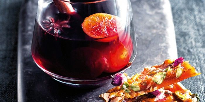Kick off your winter dinner party with this piping hot mulled wine whiskey, served alongside a sweet and salty brittle.