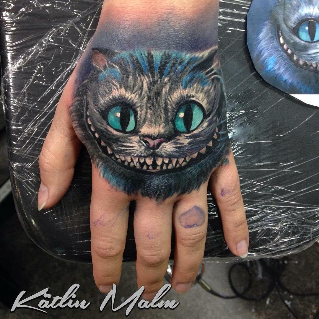 Cheshire Cat On Girl S Hand Best Tattoo Design Ideas Cheshire Cat Tattoo Cat Tattoo Wonderland Tattoo