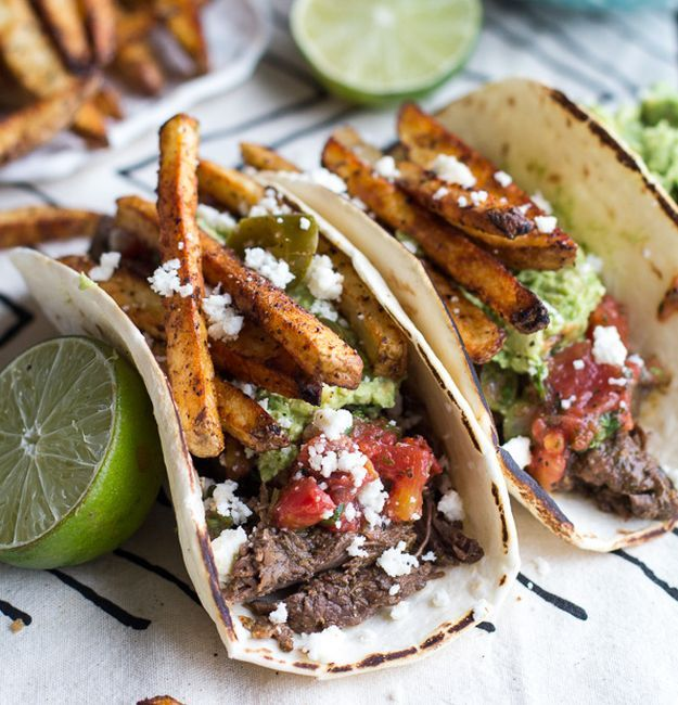 Loaded Crockpot Carne Asada Tacos | Tender, juicy and flavorful carne asada recipe = The BEST Homemade Recipe for Dinner or Parties! http://homemaderecipes.com/carne-asada-recipes/