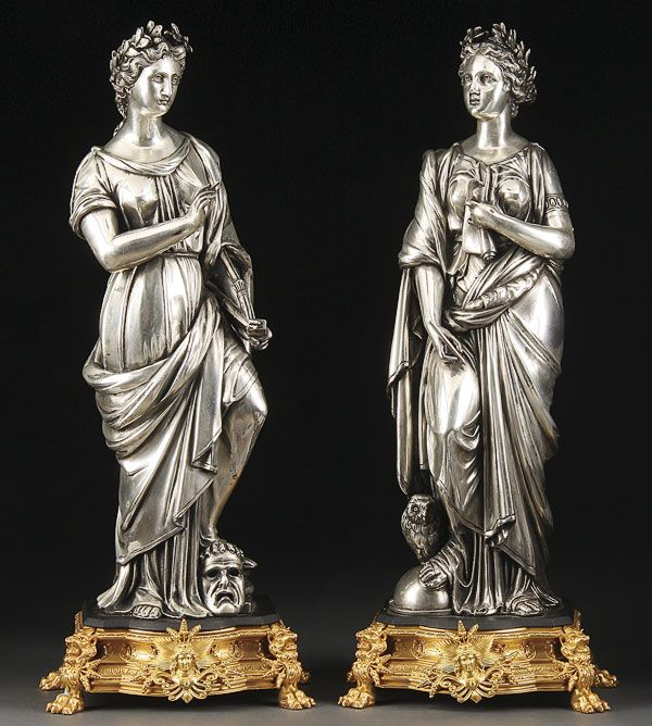 A NAPOLEON III SILVERED AND ORMOLU FIGURAL GARNITURE OF THE ARTS. The silvered classical figures of a young beauty representing literature and theater surmounting ormolu plinths with figural lions feet. Height 24.25 inches (61.5 cm).