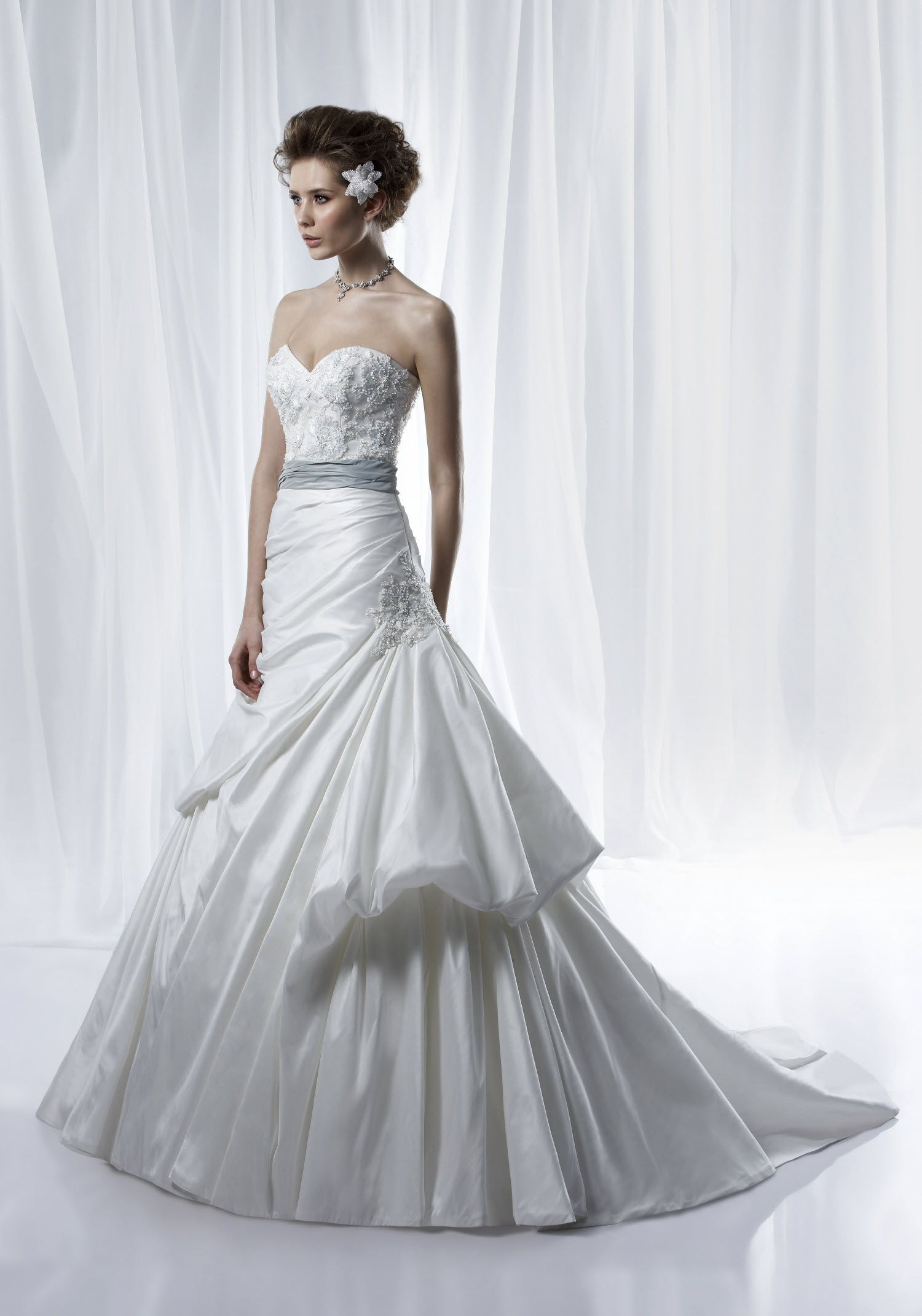 Sweetheart ball gown wedding dress  Ivory sweetheart ball gown wedding dress with modern bustle and silk