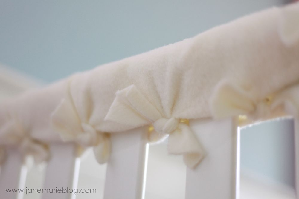 Super easy teething protector for crib. Made with fleece. Just cut and tie. I'll have to remember this for baby #2