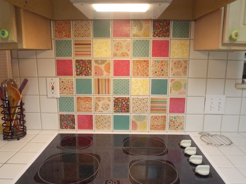 Inexpensive solution for ugly tile backsplash... mod podge and craft on ugly artwork, ugly cross decorations, ugly granite, ugly area rugs, ugly basement, ugly kitchens, ugly electrical, ugly bath, ugly farm sink, ugly ovens, ugly countertops,