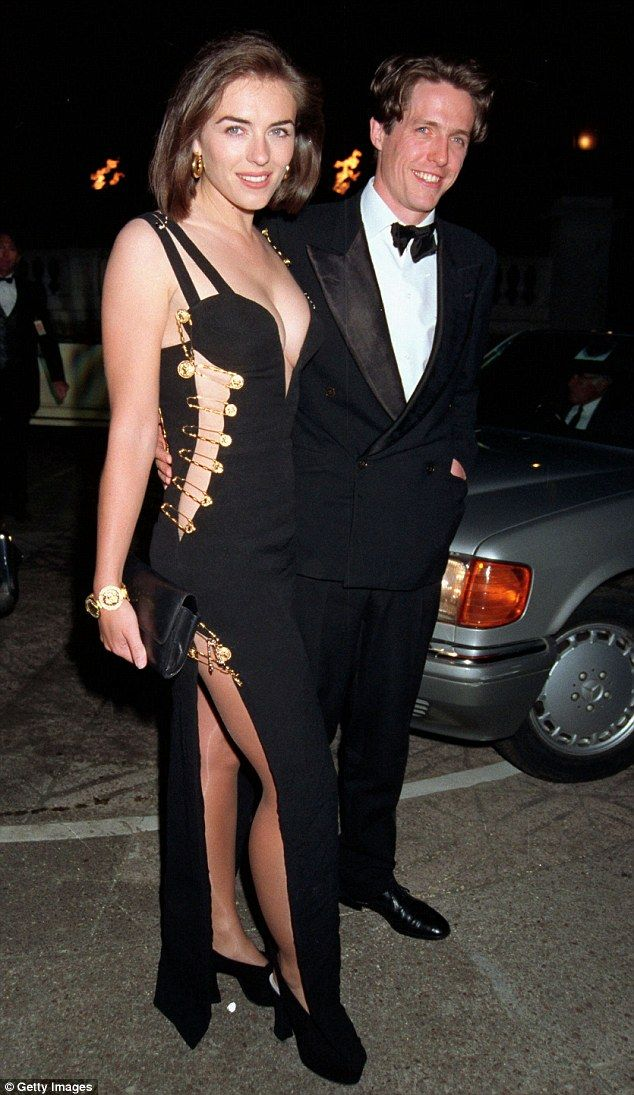 2ebb0b28f87a94 The original dress was widely credited with launching Liz Hurley s star.  Held together by safety pins it afforded more than just a glimpse of leg  and ...