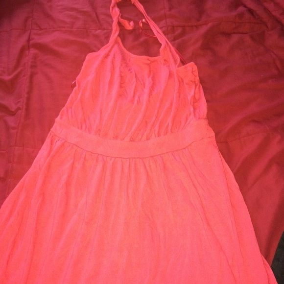 Pink sundress Flirty and fun hot pink sundress from Old Navy. It's knee length and a halter top. It goes perfectly with some strappy sandals for a cute dinner date outfit. This dress also fits a bit on the larger size. Old Navy Dresses Midi