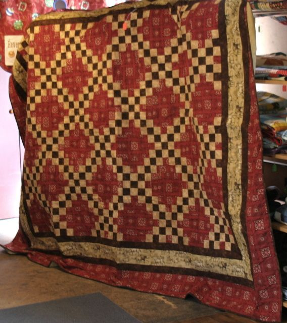 Double Irish Chain made with Red Bandana fabric for the background. Tan border is Horses! www.robinsnestquilts.com