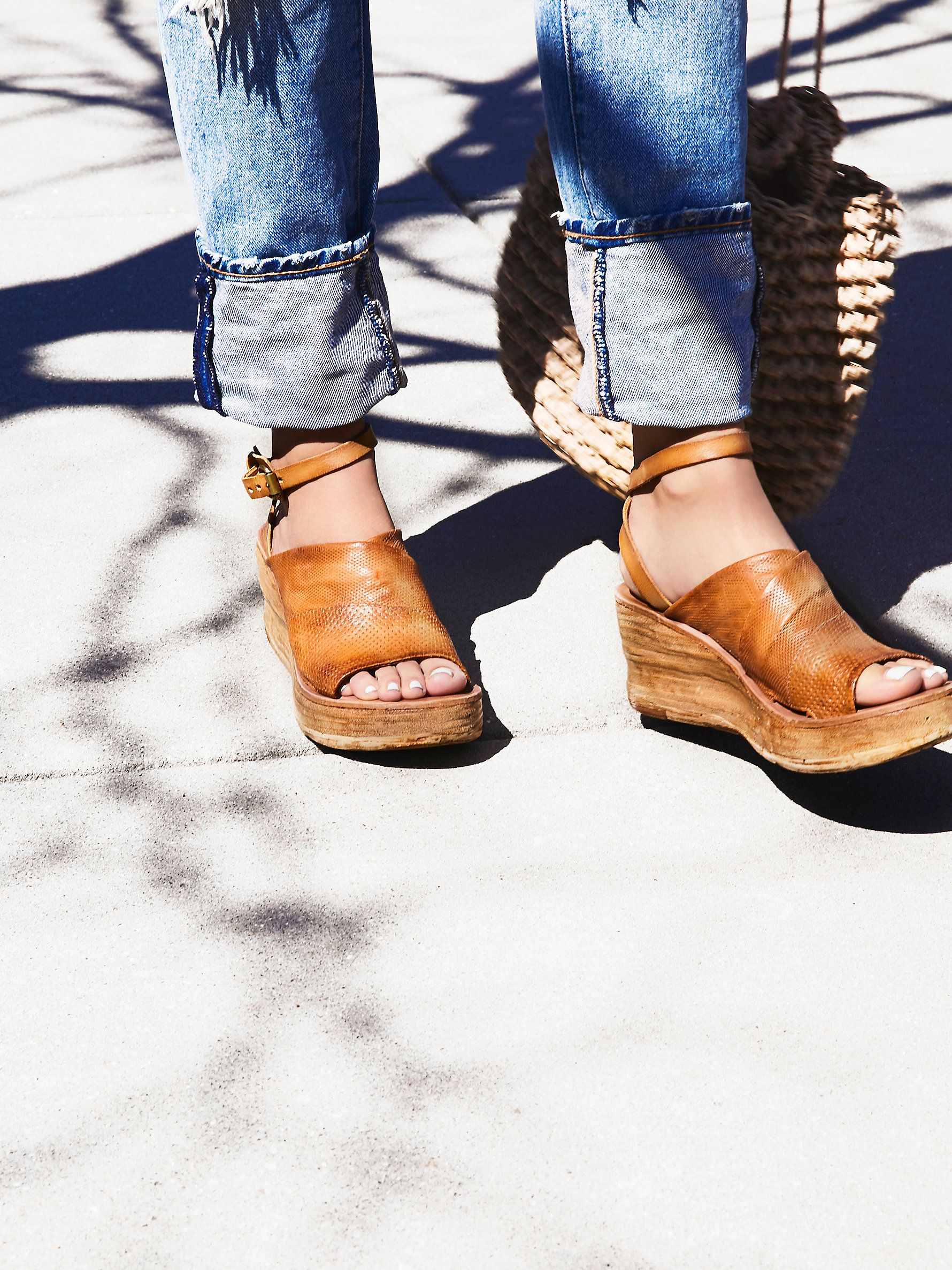 Niall Wedge   Leather wedge featuring an adjustable strap that wraps  effortlessly around the ankle. 6153f45755