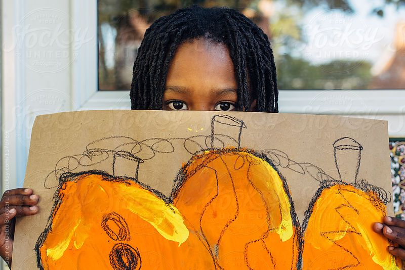 African American girl holding her pumpkin painting #fall #pumpkin #painting #kid