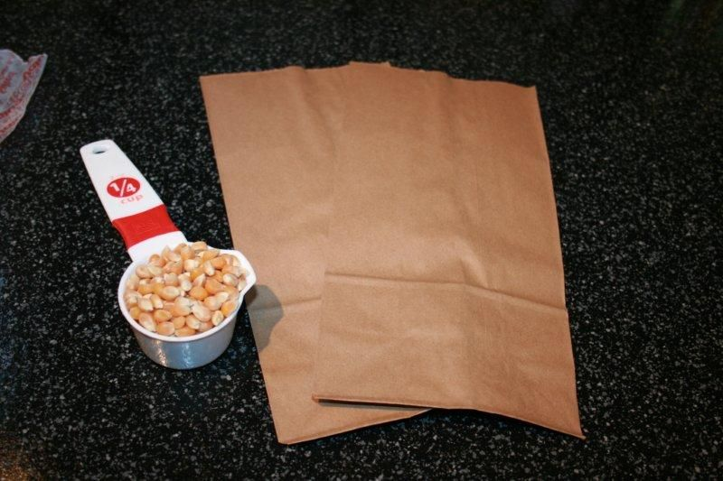 Did you know you can Make your Own Microwave Popcorn in under 4 minutes? Store bought Microwave popcorn is convenient, but it happens to be loaded with fats/oils/sodium, etc. You can make your own healthier, dirt cheap microwave popcorn, complete with various flavors of seasoning in under 4 minutes.