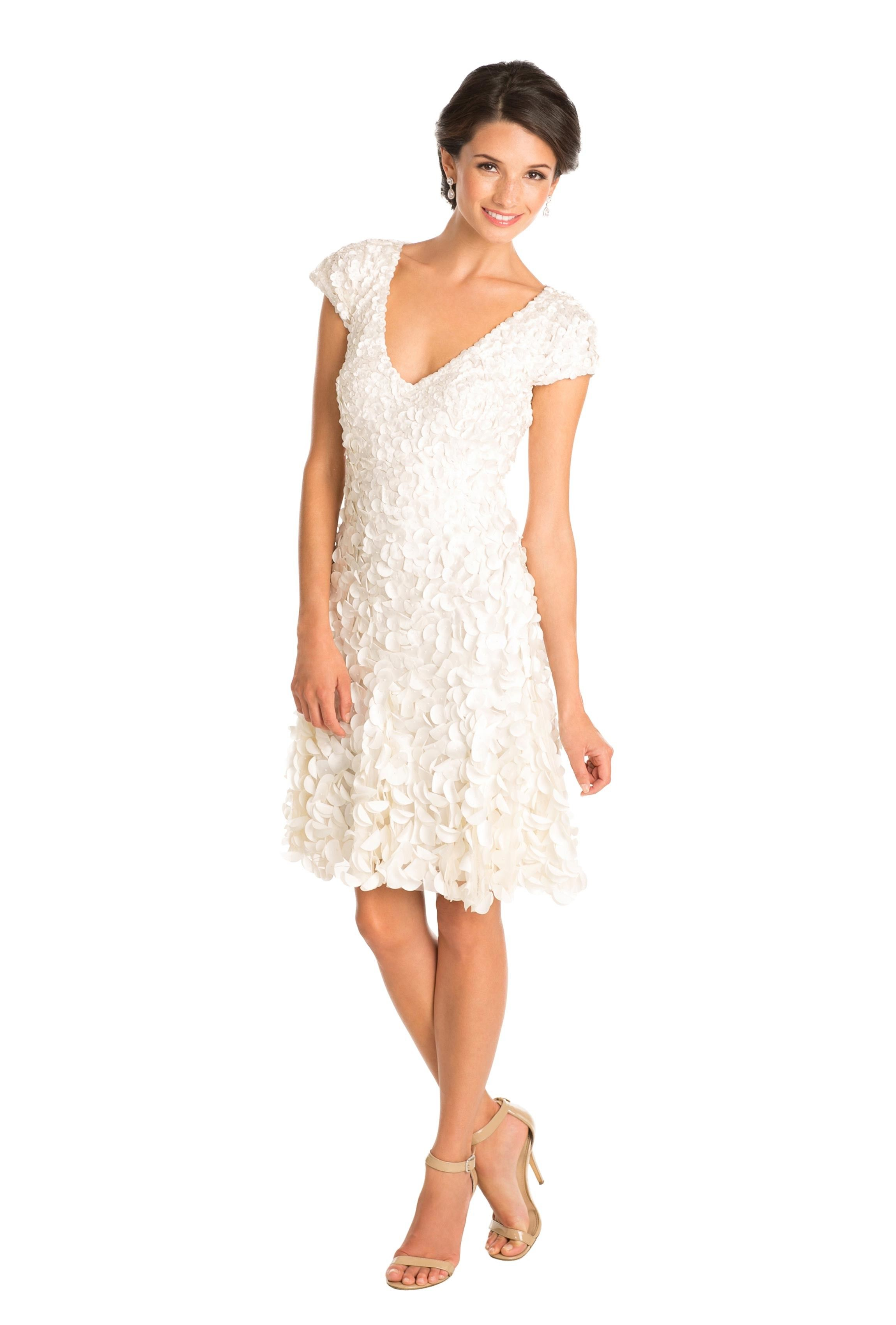 94b0ff3bef3 The Daisy by Theia is a white ivory knee-length dress with petal detail