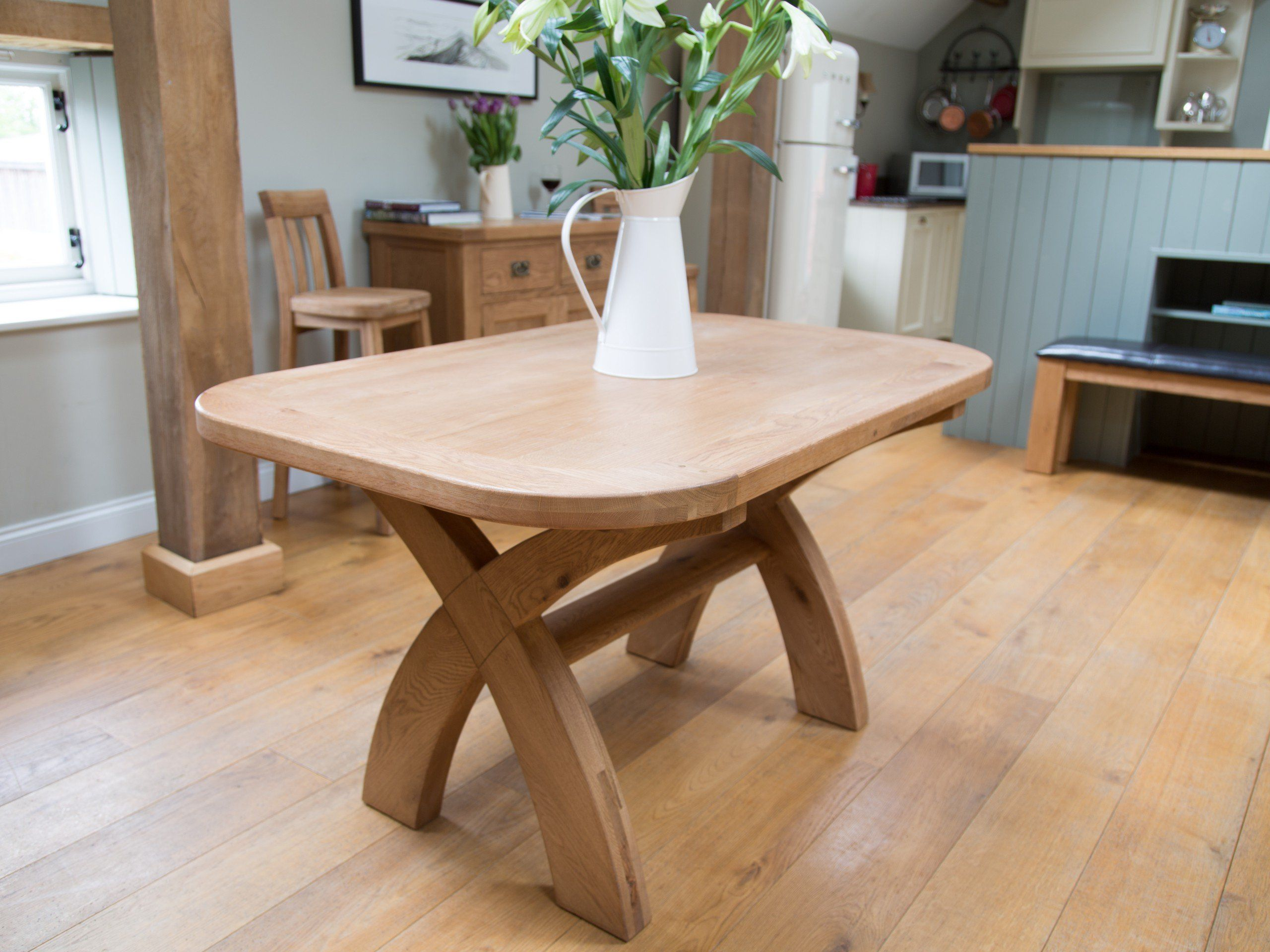 Country Oak 1 4m cross legged dining table with oval corners Seats