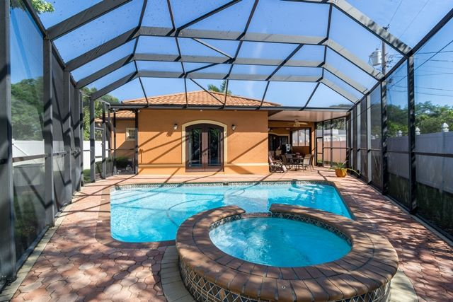 1730 Lakewood Dr S St Petersburg Fl Great Outdoor Living Area Including An Outdoor Kitchen Amazing Ho Florida Pool Outdoor Living Areas Florida Lifestyle