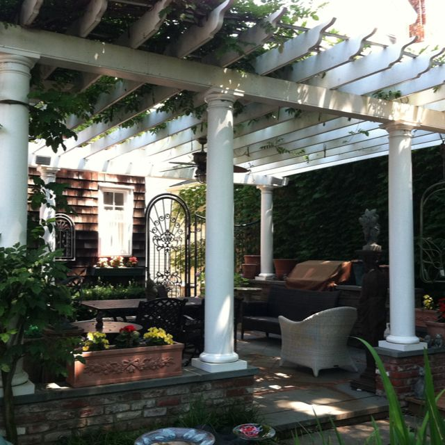 Custom trellis with vines give shade and beautiful canopy