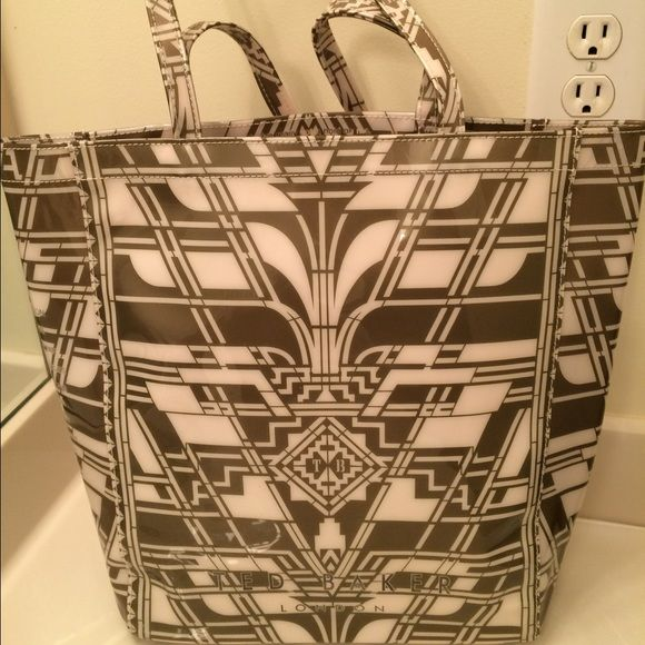 Ted Baker Authentic White/Gold Tribal Shopper Tote  Ted Baker Authentic White/Gold Tribal Print Shopper Tote. Adorable shopper tote to carry everyday. Definitely a conversation piece. No ordinary designer bag. Polyvinyl material. Measurements 14x15 Ted Baker Bags Totes