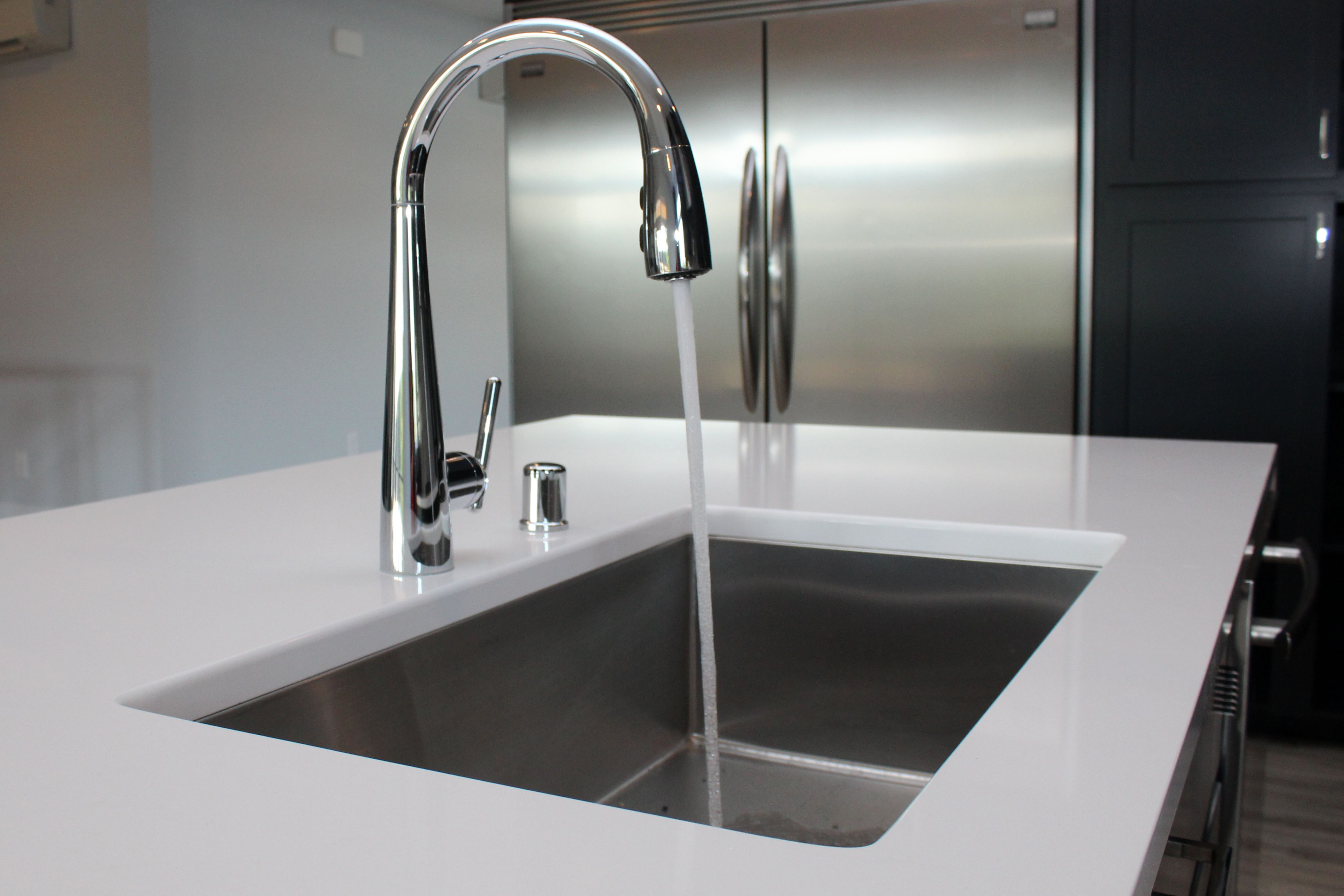 White Quartz Counter With Stainless Steel Undermount Sink And